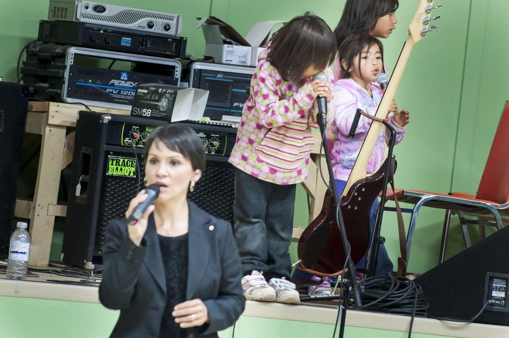 Susan, inspiring kids to sing.